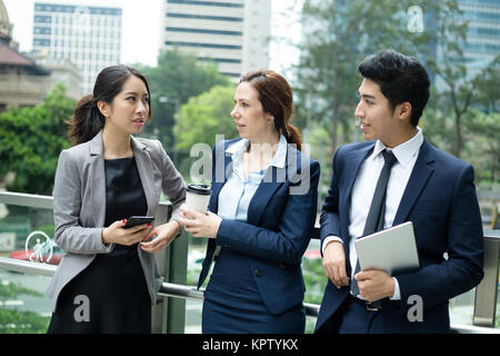 Business people talking outside office - Stock Photo