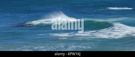 Splashing water, turquoise pacific - Stock Photo
