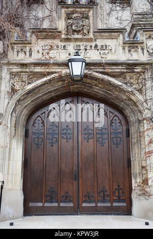 Large heavy double doors to Mandel Hall in Reynolds Club on the University of Chicago campus. - Stock Photo