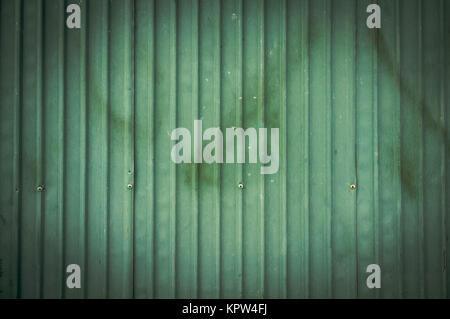 A rusty corrugated iron metal fence / Zinc wall - Stock Photo