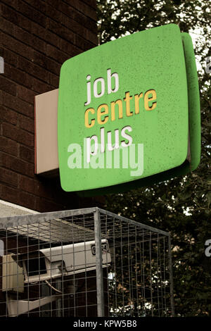 Jobcentre Plus office logo on sign and CCTV camera - Stock Photo