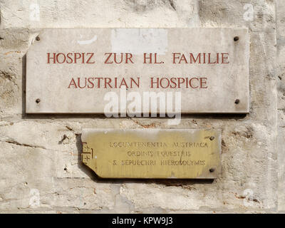 Sign for the austrian hospice of the Holy Family on the via Dolorosa in Jerusalem. - Stock Photo