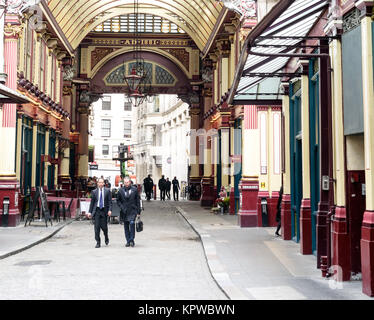 Two business man walk through the interior of the covered Leadenhall Market in London - Stock Photo