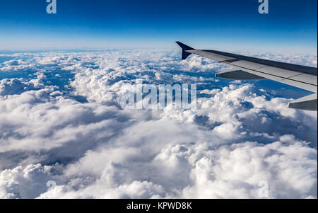 view from airplane with wing over france,atlantic and alpine - Stock Photo