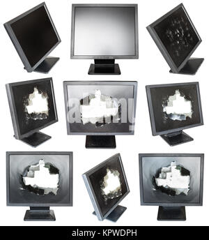 set of old black LCD monitors with damaged screens - Stock Photo