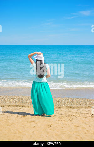 Brunette with long hair turned away - Stock Photo