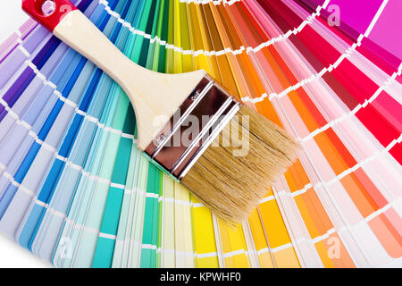 catalog with paint color samples and brush - Stock Photo