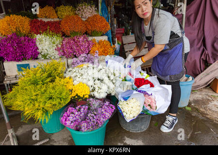CHIANG MAI, THAILAND - AUGUST 24: Woman sells flowers at the local market on August 24, 2016 in Chiang Mai, Thailand. - Stock Photo