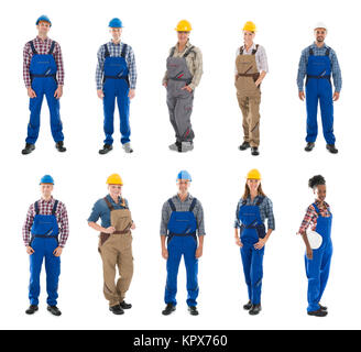 Portrait Of Confident Male Carpenters Standing In Row - Stock Photo