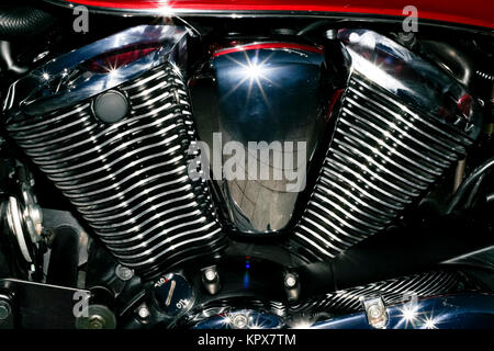 Chromed engine with starry reflections - Stock Photo