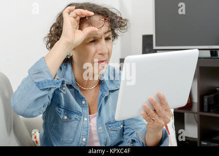 a middle-aged woman with eyes pain - Stock Photo