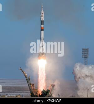 The Russian Soyuz rocket and Soyuz MS-07 spacecraft blast off from the launch pad carrying the International Space - Stock Photo