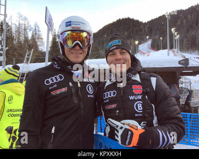 Alta Badia, Italy. 16th Dec, 2017. German ski racers Alexander Schmid (L) and Manuel Schmid standing in the finish - Stock Photo