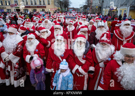Participants during an annual holiday procession of Fathers Frost (Fathers Christmas) on central street in Rybinsk - Stock Photo