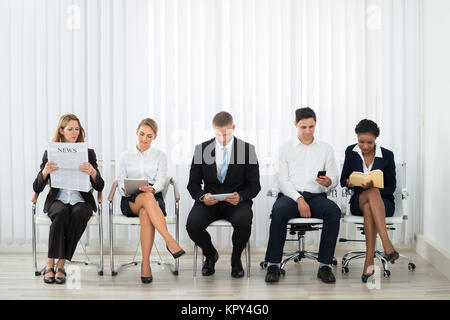 Businesspeople Waiting For Interview - Stock Photo