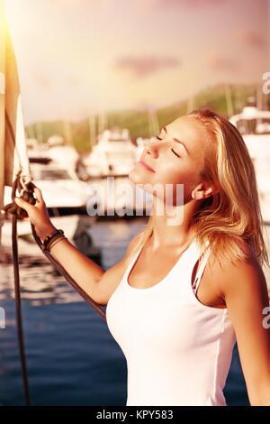 Woman enjoying energy of the sun - Stock Photo