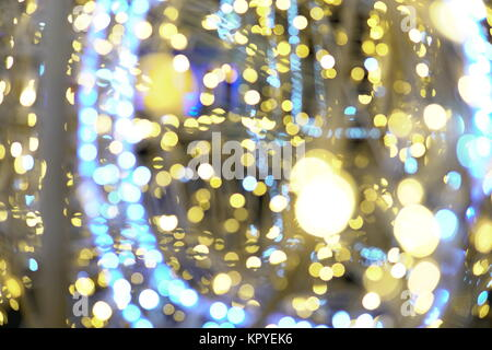 Garland lights Bokeh texture background different colors - Stock Photo