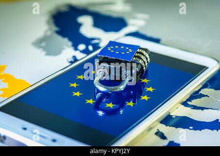 Padlock over a smartphone and EU map, symbolizing the EU General Data Protection Regulation or GDPR. Designed to - Stock Photo