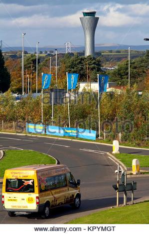Edinburgh airport shuttle bus and Air Traffic Control Tower, Scotland - Stock Photo