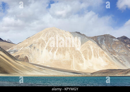 Military buildings on the banks of beautiful Pangong Tso lake in the surreal landscape in indian himalayas, Ladakh, - Stock Photo