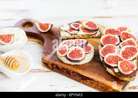 Various Healthy snacks from rice cake, wholegrain rye crispbread crackers and sourdough bread toasts together with - Stock Photo