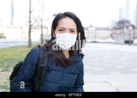 Woman wearing face mask at outdoor - Stock Photo