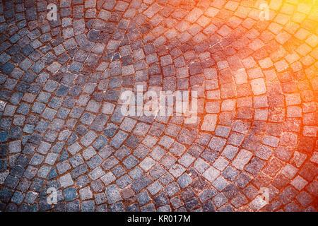 Cobble stone street background at sunset, Italy. Europe - Stock Photo