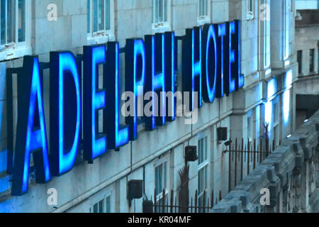 Blue neon sign for Britannia Adelphi Hotel on external hotel wall just below roof level in  city centre location - Stock Photo
