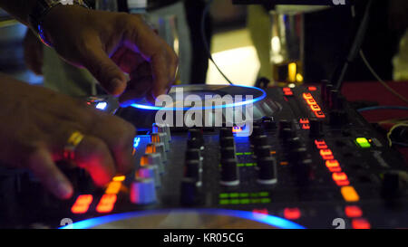 Close up of dj playing party music on modern cd usb player in disco club - Nightlife and entertainment concept. - Stock Photo