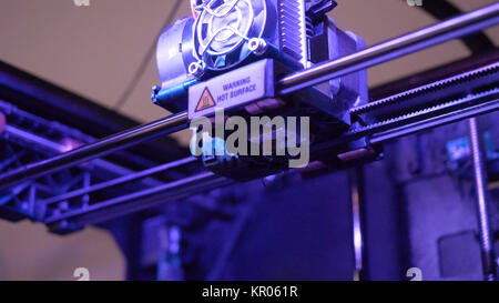 Close-up of 3D printer working. Head of 3d printer in action. 3D printer is a new generation of technology is not - Stock Photo