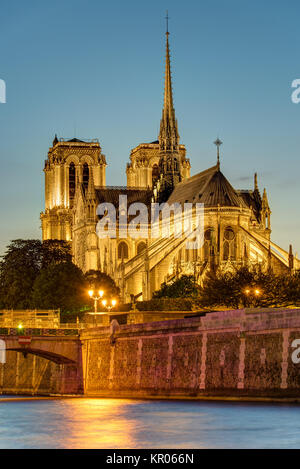 the famous cathedral of notre dame in paris after sunset - Stock Photo