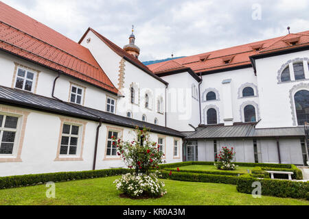 The cloister of Stift Stams, a baroque Cistercian abbey in the municipality of Stams, state of Tyrol, western Austria - Stock Photo