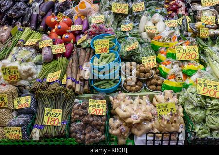 Kanazawa - Japan, June 8, 2017: Variety of fresh vegetables and price tags at the Omicho Market - Stock Photo