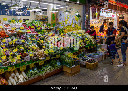 Kanazawa - Japan, June 10, 2017: Variety of fresh raw vegetables for sale at the Omicho Market - Stock Photo