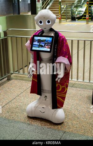 Kanazawa - Japan, June 10, 2017: Information robot at the entrance of a travel agency in Kanazawa - Stock Photo