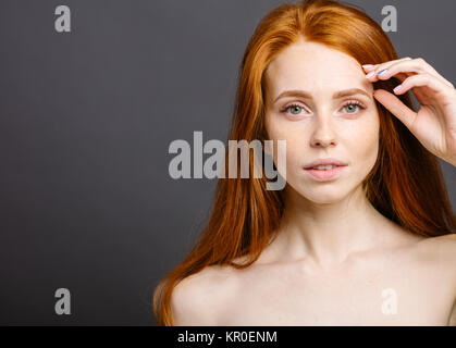 happy woman with cute smile, ginger hair and perfect healthy freckled skin - Stock Photo