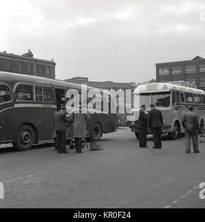 1950s, historical picture of two coaches at Kings Cross Coach station, one taking passengers to Jaywick Sands via - Stock Photo