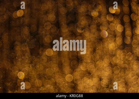 Blured yellow lights in the dark scene - Stock Photo