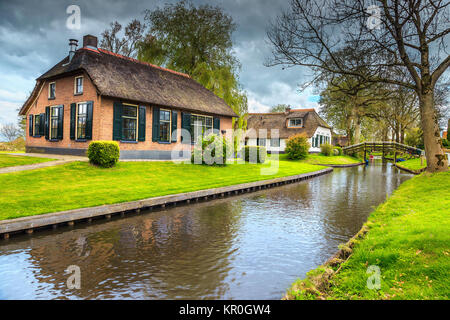 Spring village landscape, stunning traditional dutch village with wooden bridges and water canals, Giethoorn, Netherlands, - Stock Photo