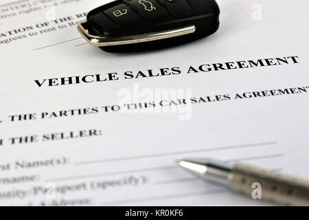 An concept Image of a vehicle sales agreement - Stock Photo