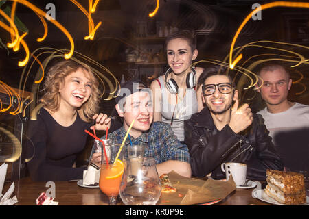 friends having fun and drinking beer in night club. long exposure - Stock Photo