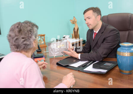 talking about the plaque - Stock Photo