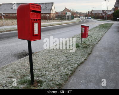 Royal Mail red lamp style letter box / post box and a red fido (dog waste) bin on Hartree Way in Kesgrave, Suffolk. - Stock Photo