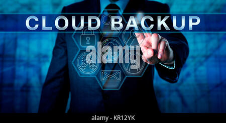 Enterprise End User Touching CLOUD BACKUP - Stock Photo