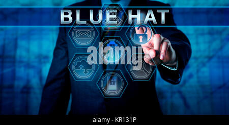 Blue Chip Software Engineer Pressing BLUE HAT - Stock Photo