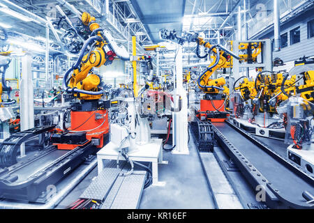 robots in a car factory - Stock Photo