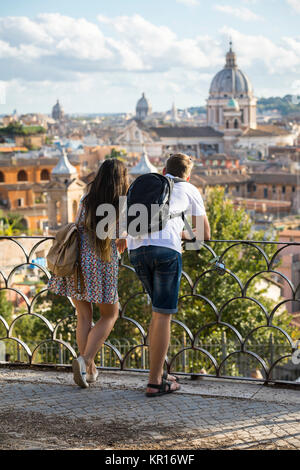 Tourists admiring the view. Rome, Italy - Stock Photo