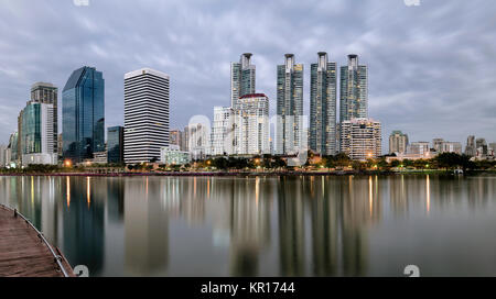 BANGKOK, THAILAND - DECEMBER 17, 2017:  Early evening just after sunset as seen from Benjakitti Park in central - Stock Photo