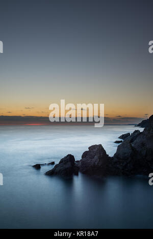 Soar Mill Cove sunset in the South Hams South Devon - Stock Photo
