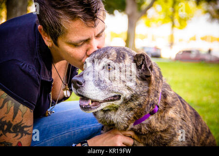 Woman in the park kissing her pitbull dog, Saint Petersburg, Florida, United States